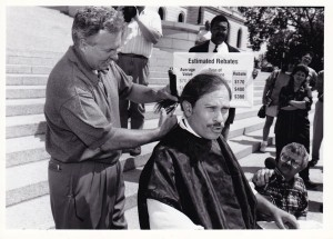 "Ken, the Capitol Barber, in 1997, a year after ""I won't get my hair cut until our tax system is more progressive.""  Also Committee Administrator Chris Crutchfield and CCO reporter Eric Eskola"
