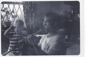 one yr old w J on clarinet